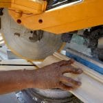 cutting a wood for molding using a miter saw