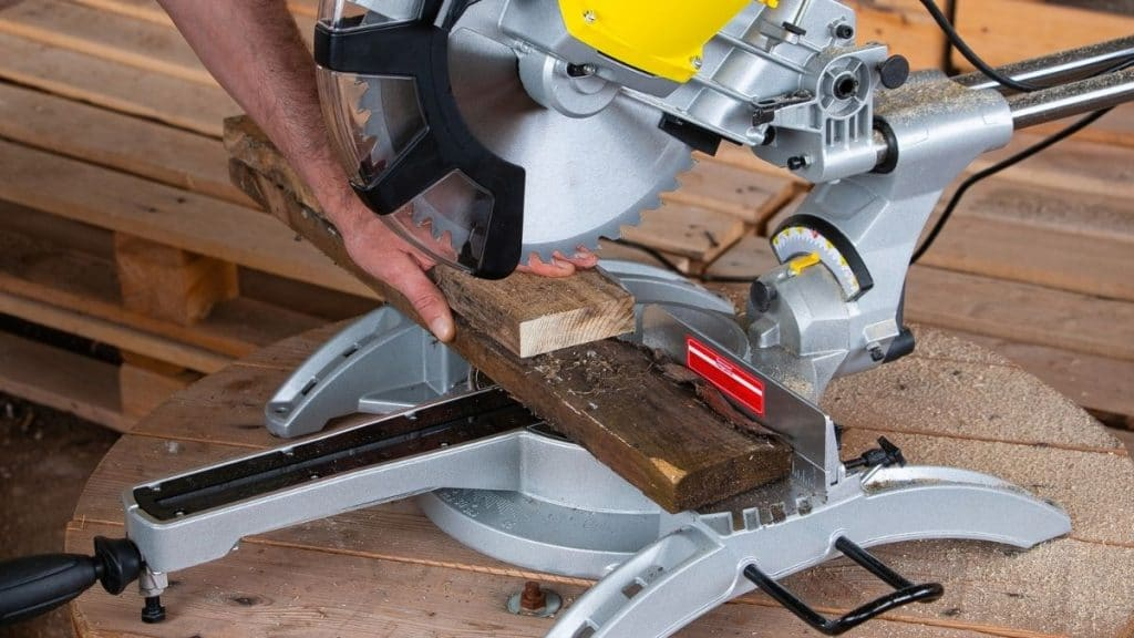 Miter saw for cutting a tree